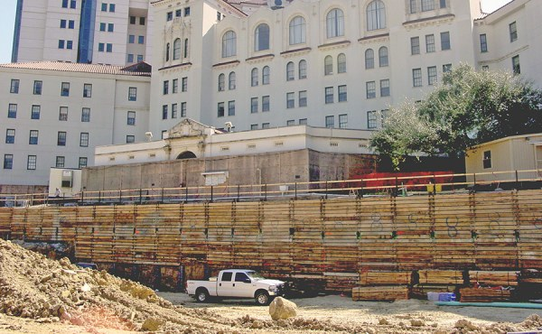 Geosyntec overcame the challenges associated with proximity to existing foundation structures and other underground obstacles to design an excavation that minimized performance risk.
